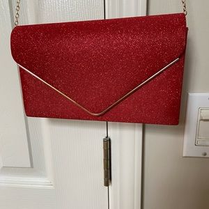 NWOT Red clutch with an option chain